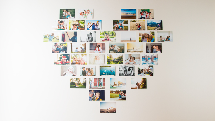 Arrange photos in shape of a heart on the wall