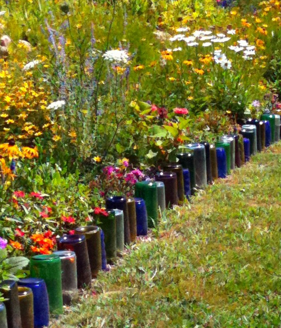 Great Eco Friendly Idea To Upcycle Glass Bottles Into A Colorful Border For  A Flower Garden. Pictures Gallery