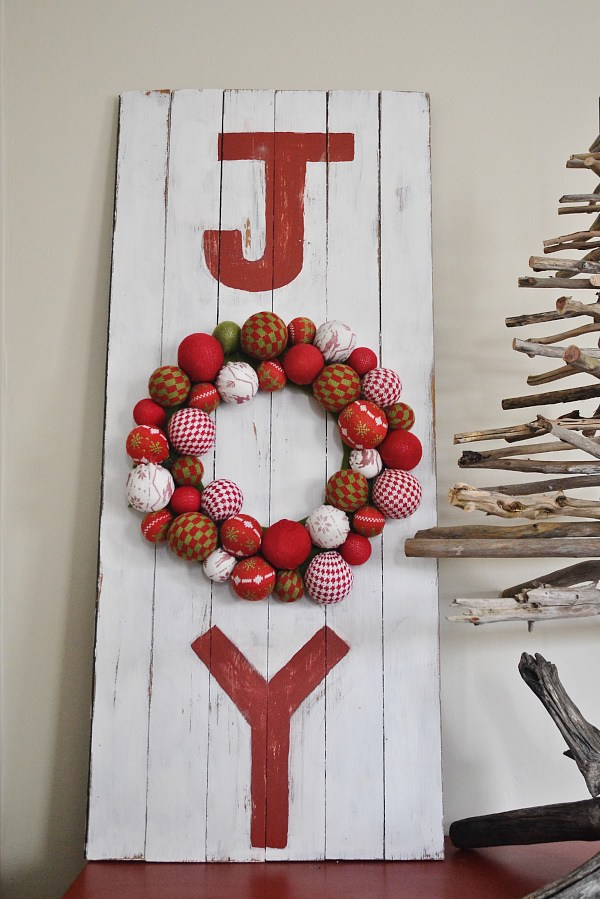 "A Joy sign where the ""O"" is a wreath"