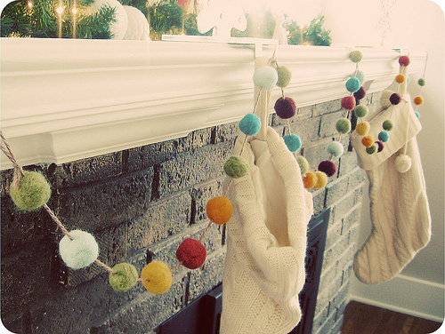 Add a simple pop of color to your mantle or to windows with this felted garland