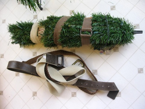 Cinching up your tree with belts to make it a more manageable, storable size