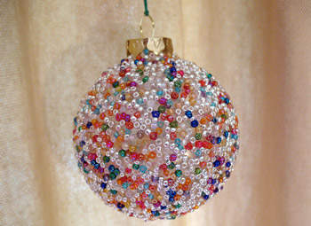 Cover a glass ball ornament with glue and seed bead balls
