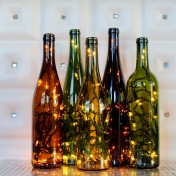 Fill wine bottles with lights to make a spectacular centerpiece