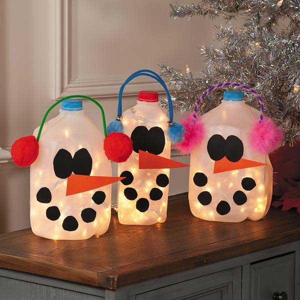 Glowing Snowmen made from empty milk jugs