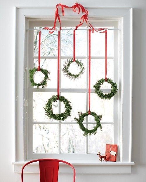 Lovely Green Wreaths Hung on Window's Top