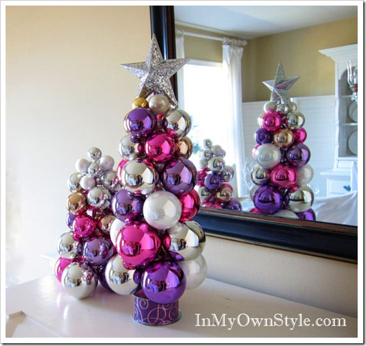 Make a tabletop tree using a knitting needle and ball ornaments
