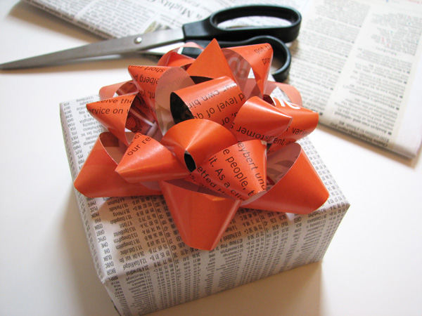 Make gift bows from a magazine page for birthday or holiday presents