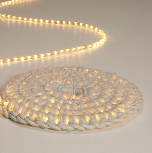 Make this cool light carpet by crocheting a strand of lights within a rug