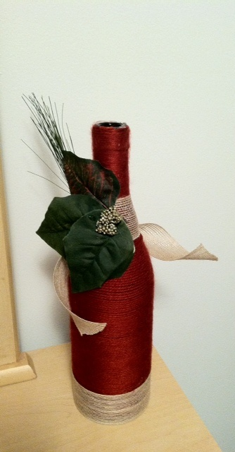 Red yarn wrapped wine bottle