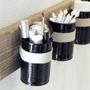 Turn tin cans into wall organizer