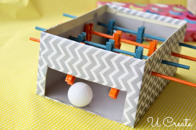 Upcycle a shoebox into a homemade foosball game