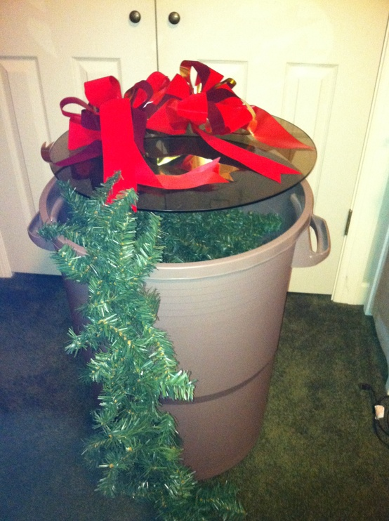 Use a clean trash bin to store garlands and outdoor Christmas decor