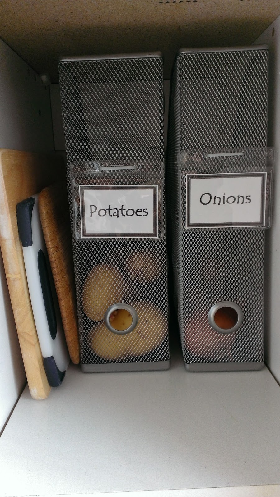 Use magazine holders to keep your onions and potatoes