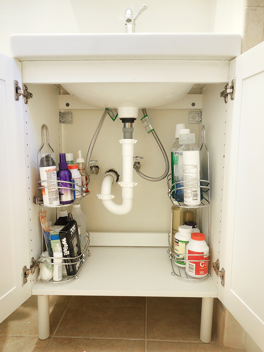 Use shower caddies as shelving to organize awkward sink spaces