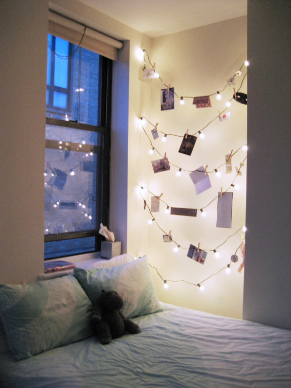 Use string lights with clothespins to hang photographs