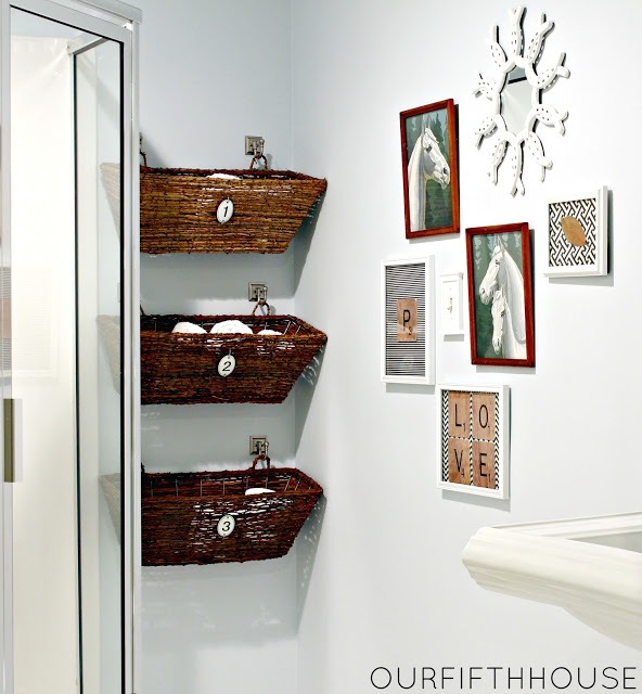 Use wicker window boxes for holding towels and toilet paper