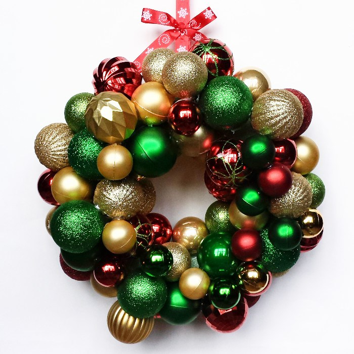 festive Christmas ornament wreath using supplies from the Dollar Tree