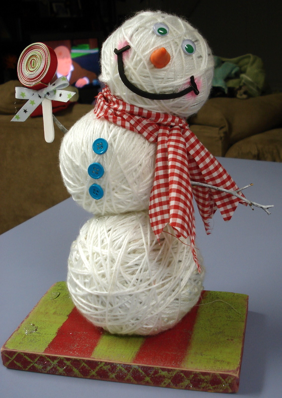 snowman made from yarn balls