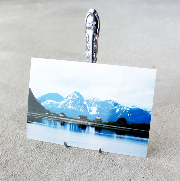 Bend your fork into a photo holder