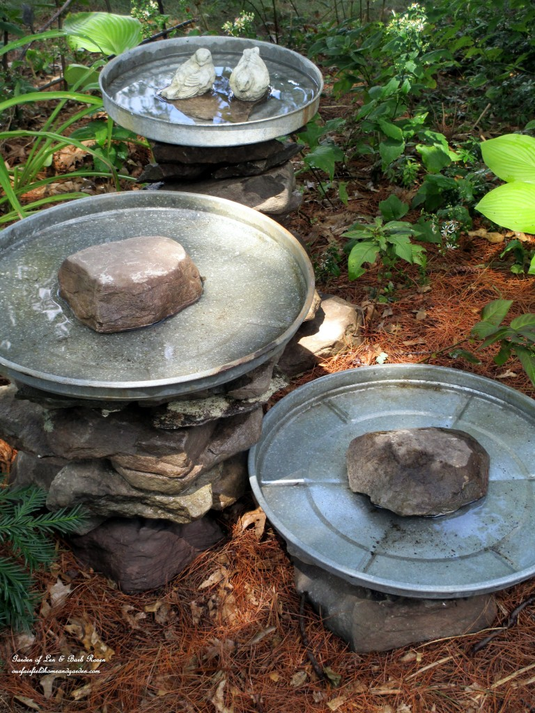 Birdbath made with large galvanized pan and rocks