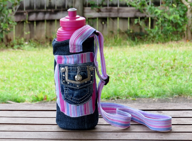 Create a funky water bottle carrier using an old pair of jeans and some pretty fabric