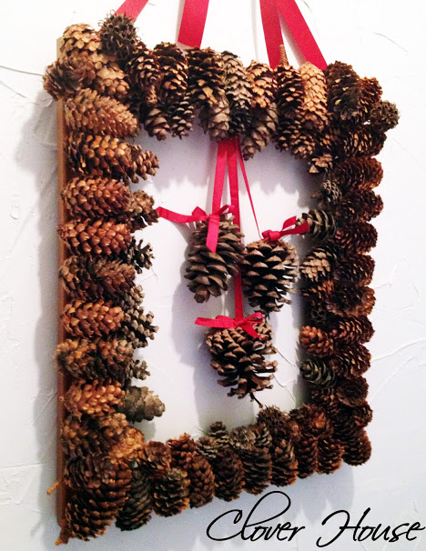 Create a wreath using picture frame and pine cones
