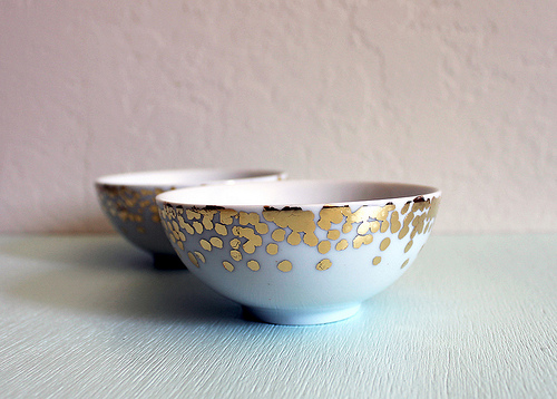 Decorate plain ceramic dishes and bowls with a gold leaf technique