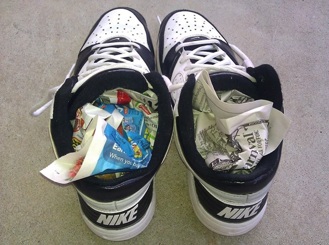Dry your wet shoes faster by putting crumpled balls of newspaper inside them