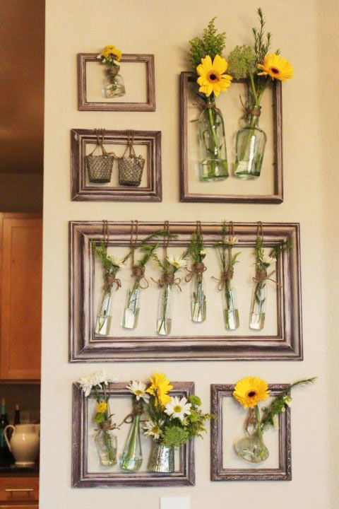 Fill your blank walls with fresh flowers by hanging jars inside old picture frames