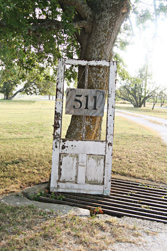 Hang a number sign from an old wooden door