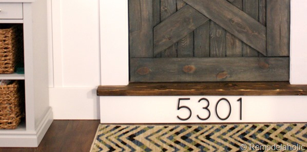 Install house numbers on your front porch's stair riser