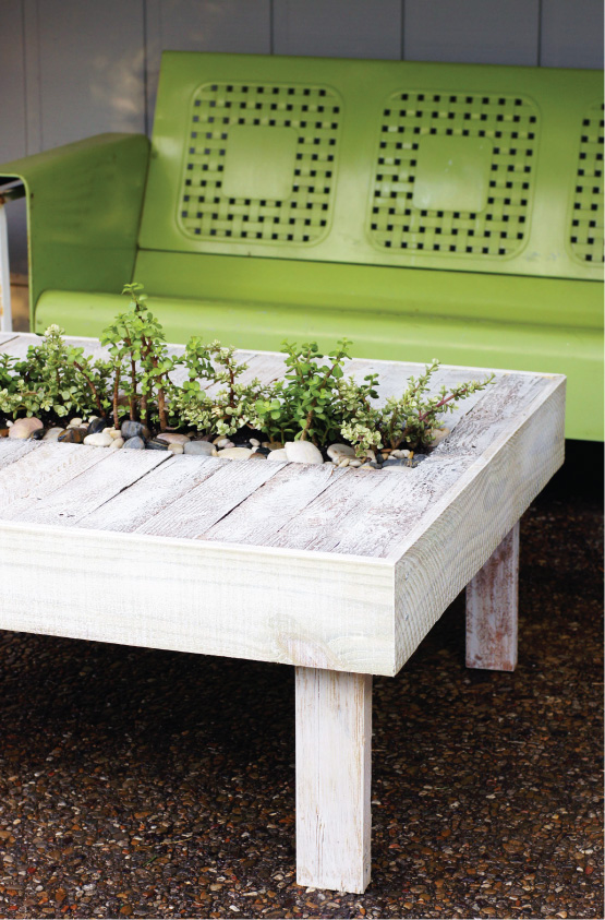 Make a garden table out of an old pallet, then add plants in the middle