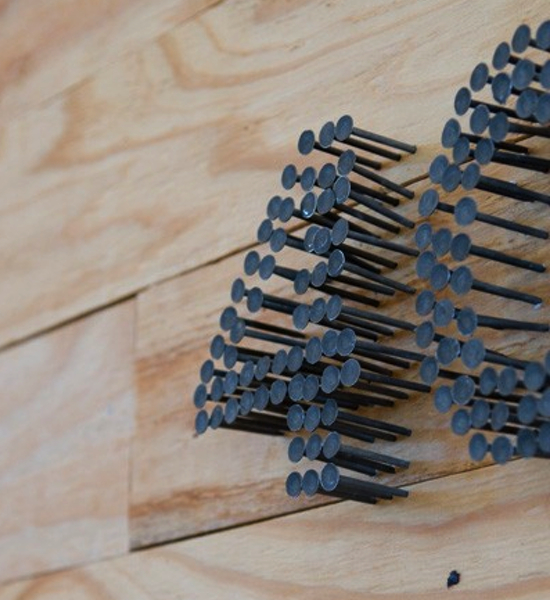 Make a house number from nails and a little leftover wood