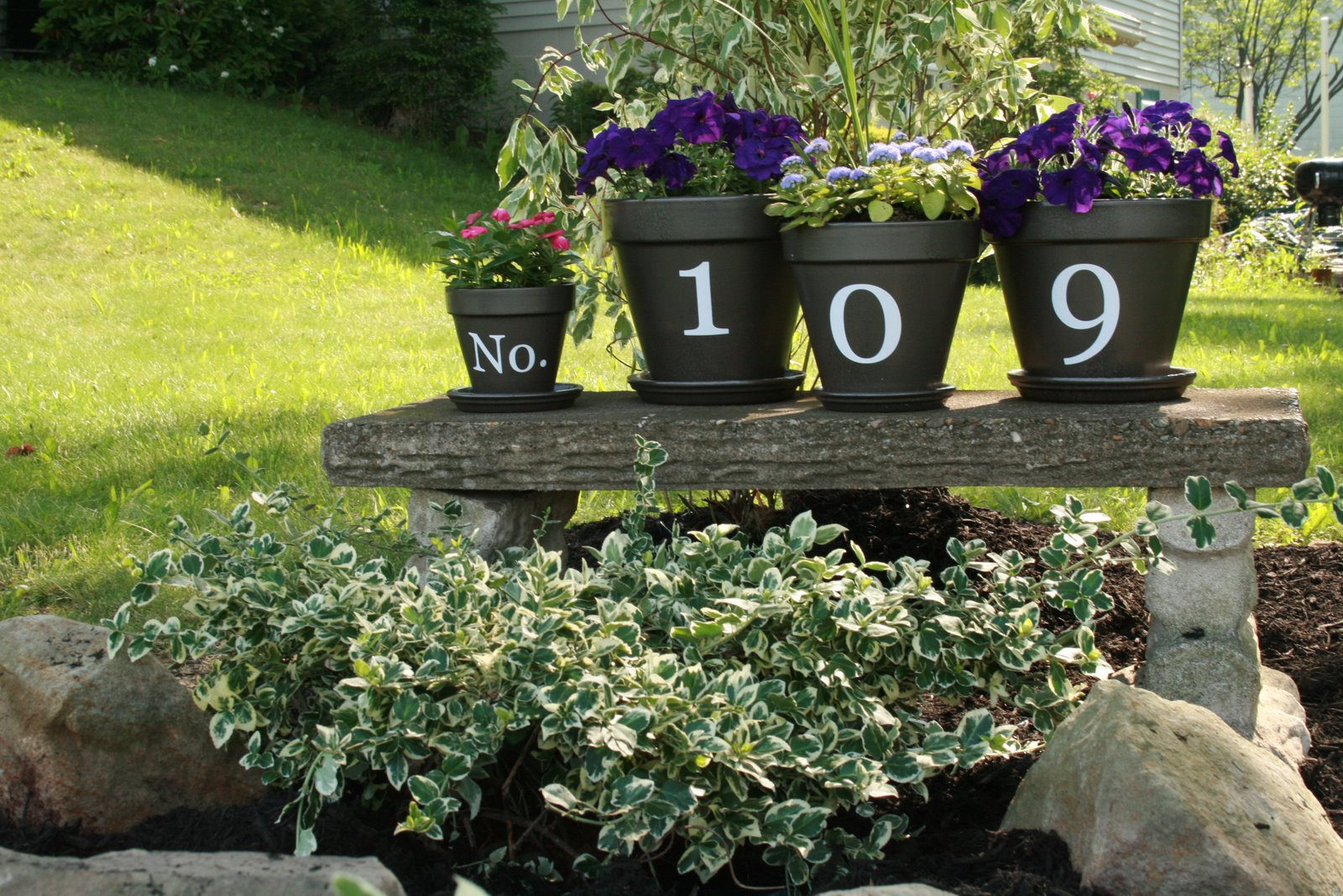 Paint each number on a different flower pot