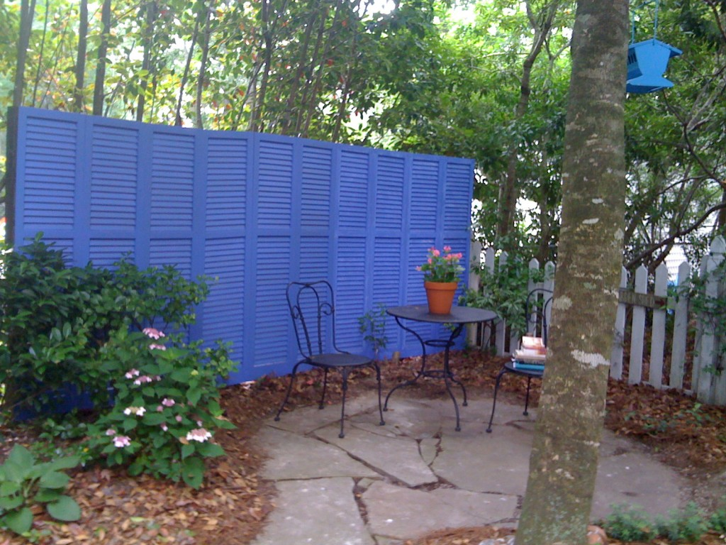 Privacy fence made of assortd old shutters
