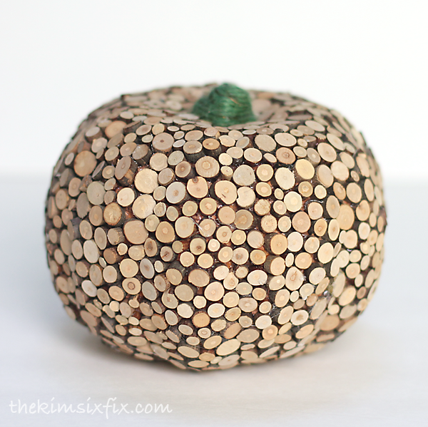 Transform a styrofoam pumpkin into high end decor using slices of wood