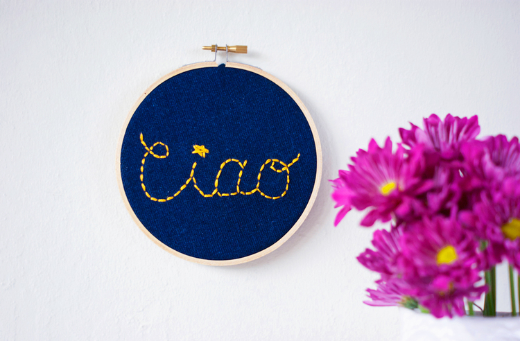 Turn old jeans into this charming embroidered wall sign