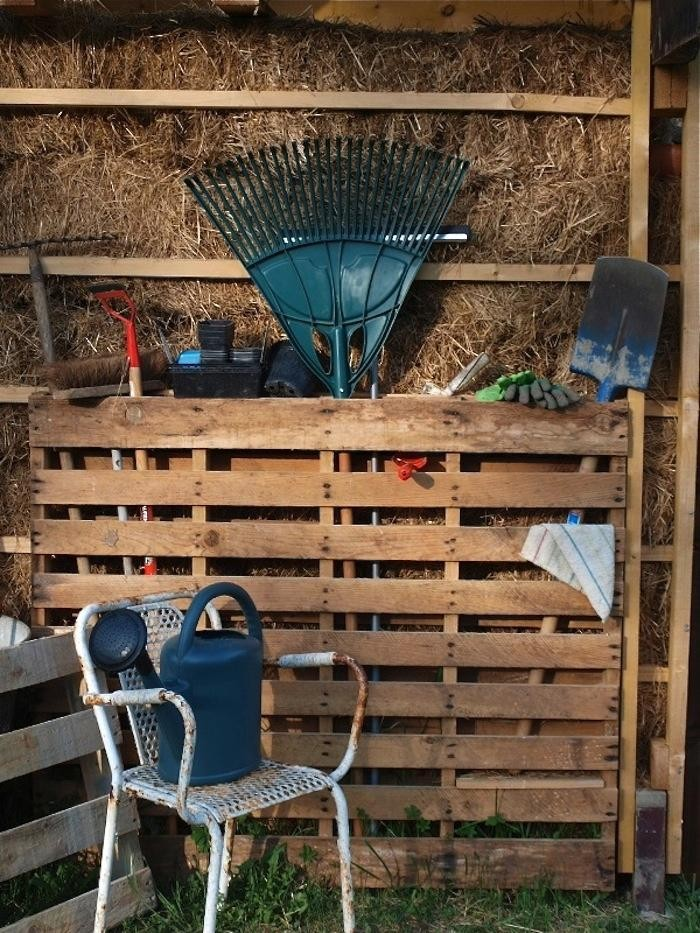 Use a recycled wooden pallet to corral garden tools