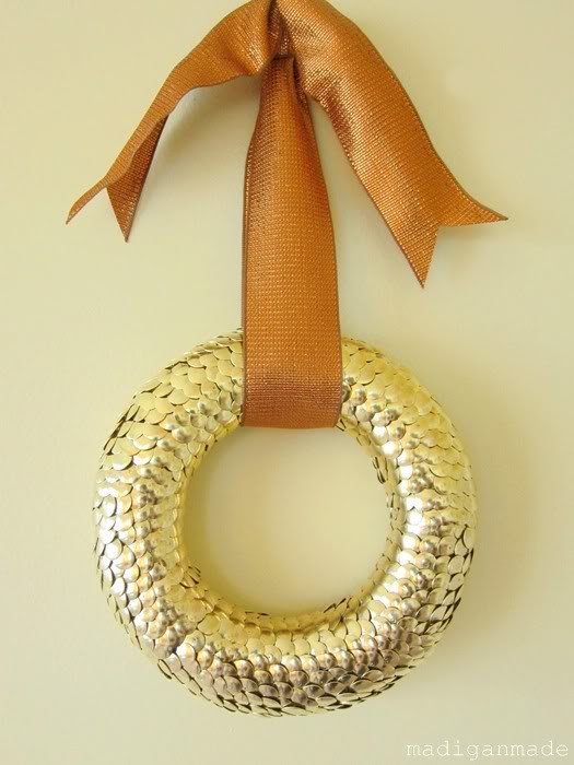 Use brass thumbtacks to create a golden and textured wreath