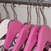 Use soda can tabs to create double coat hangers