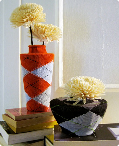 Dress up your flower pots with colorful socks to brighten up your space