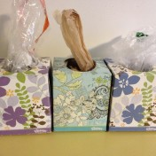 use a tissue box to easily store and dispense plastic grocery bag